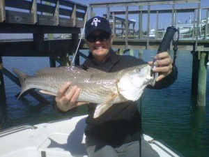 NC inshore fishing charters client with a redfish